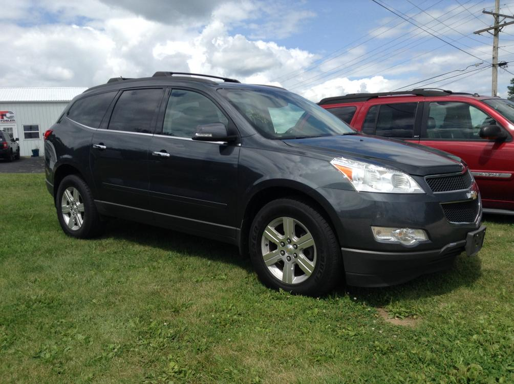 2011 Deep Quartz Met Chevrolet Traverse LT FWD (1GNKRGED1BJ) with an 3.6L V6 DOHC 24V engine, 6-Speed Automatic transmission, located at 1800 South Ihm Blvd, Freeport, IL, 61032, (815) 232-5543, 42.278645, -89.607994 - Photo #0