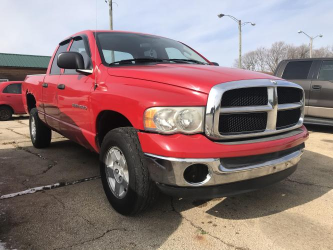 2005 Indy Red Dodge Ram 1500 Laramie Quad Cab Long Bed 4WD (1D7HU18N45J) with an 4.7L V8 SOHC 16V engine, 5-Speed Automatic Overdrive transmission, located at 1800 South Ihm Blvd, Freeport, IL, 61032, (815) 232-5543, 42.278645, -89.607994 - Photo #0