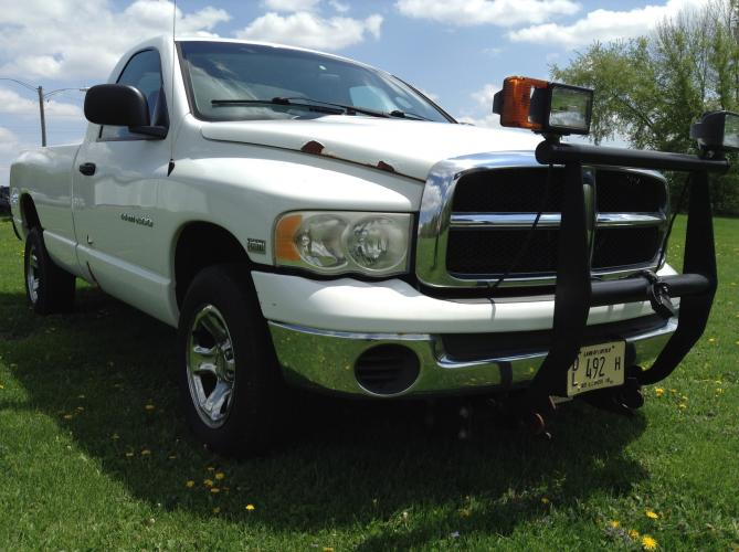 2004 Arctic White Dodge Ram 1500 Laramie 4WD (1D7HU16D04J) with an 5.7L V8 OHV 16V engine, 5-Speed Automatic Overdrive transmission, located at 1800 South Ihm Blvd, Freeport, IL, 61032, (815) 232-5543, 42.278645, -89.607994 - Photo #2